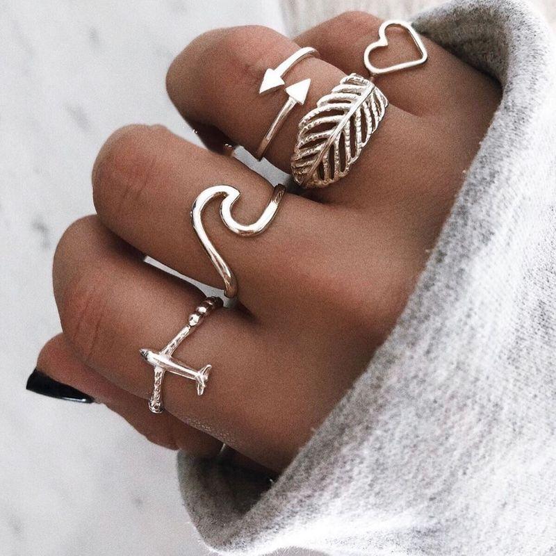 New ring wholesale yiwu nihaojewelry fashion airplane spray ring plume leaves love ring set NHGY213339