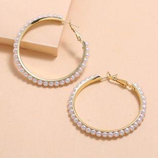 Nueva moda retro círculo pendientes simples pendientes de perlas silvestres nihaojewelry al por mayor NHKQ213367's discount tags
