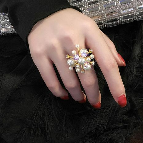 Korean new fireworks pearl rhinestone ring opening ring wholesale NHNT207255's discount tags