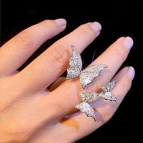 Couleur en trois dimensions trois anneaux de papillon flash diamant micro-ensemble zircon index ouvert bague pour les femmes en gros NHNT207259's discount tags