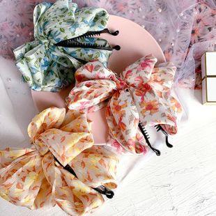 Nueva moda coreana floral doble bowknot horquilla barata al por mayor NHHI207389's discount tags