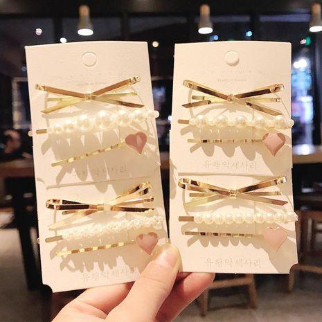 3-piece hair clip Korean style simple pearl bowknot love cheap wholesale hairpin NHDQ207399's discount tags