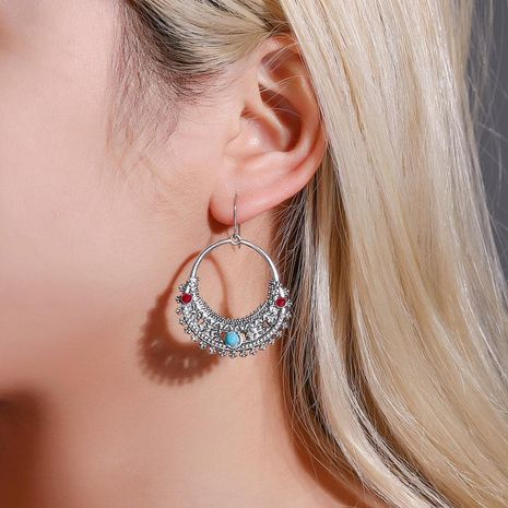New fashion pattern half moon turquoise retro hollow carved earrings wholesale NHMO207813's discount tags