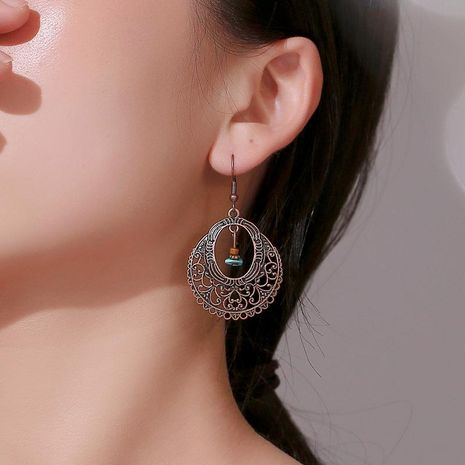 New fashion classical hollow carved turquoise earrings female retro pattern old earrings wholesale NHMO207818's discount tags
