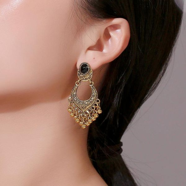 New fashion retro exaggerated earrings exotic ethnic folk carved beads tassel earrings wholesale NHMO207826
