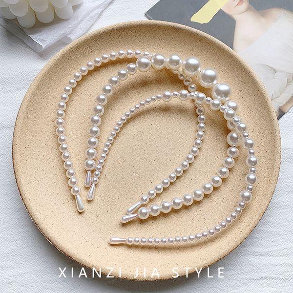 simple perla pelo aro hembra salvaje fuera diadema presión cabello paquete horquilla super hada diadema nihaojewelry al por mayor NHOF215329
