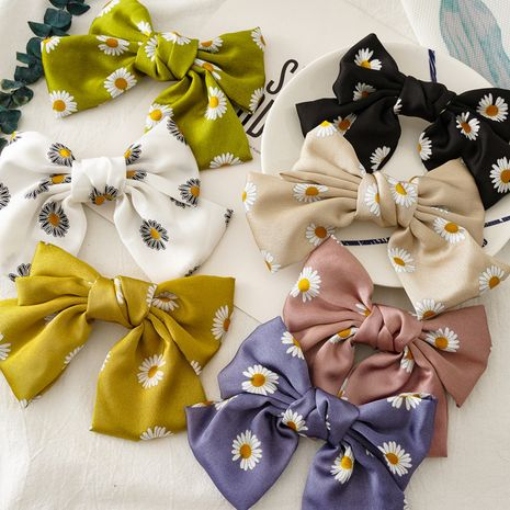 Korean small daisy knotted bow hairpin girl plate hair satin double spring clip accessories nihaojewelry wholesale  NHOF215334's discount tags