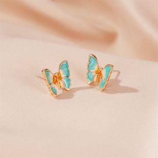 Coreano nuevo super hada pintura al óleo textura mariposa pendientes estilo antiguo gradiente mariposa alas pendientes nihaojewelry al por mayor NHDP215308's discount tags