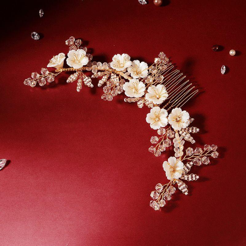 Korean fashion  bridal headdress acrylic white elegant flower hair comb rice bead crystal exquisite comb  hair accessory NHHS216040