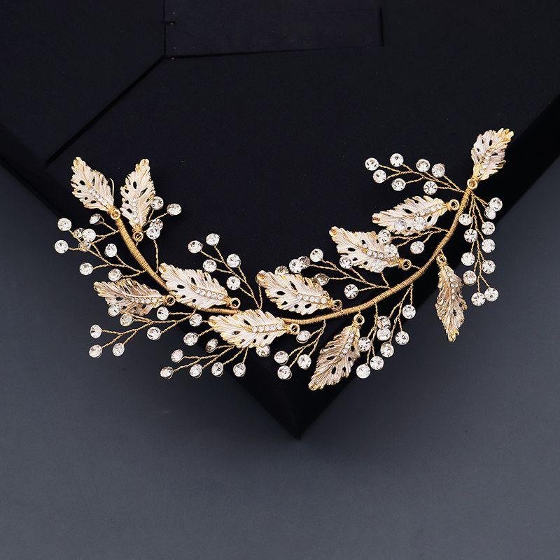 fashion retro  ancient style headdress creative hollow leaf headband handmade pearl pressure  wedding hair band  NHHS216041