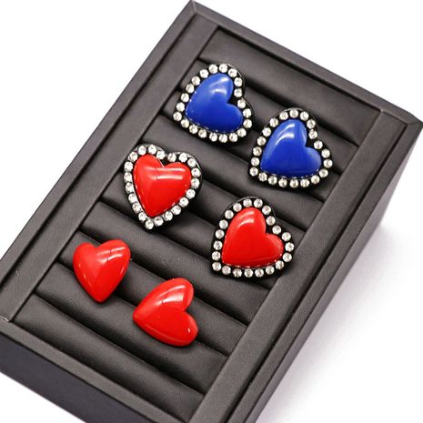 Korean fashion new  red blue resin silver needle earrings heart-shaped side drill earrings red heart-shaped resin earrings NHOM216061's discount tags