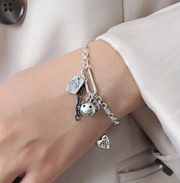 fashion retro simple multi-element pendant personality girl bracelet wholesale NHSC217007's discount tags