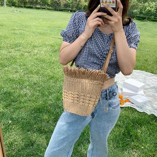 Straw bag  summer  simple new female bag hand-woven shoulder messenger bag bucket seaside holiday beach bag nihaojewelry wholesale NHGA216833's discount tags
