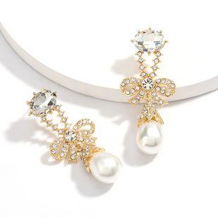 Fashion design sense rhinestone diamond bow pearl earrings retro temperament earrings NHJE217065's discount tags