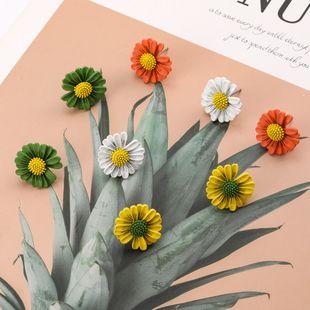 small fresh alloy spray painting small daisy flower earrings girl heart cute earrings wholesale NHJE217073's discount tags