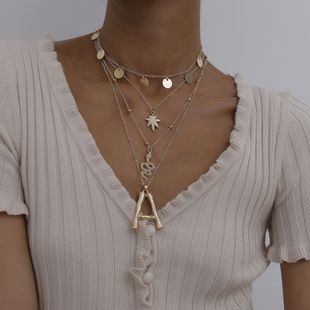 Fashion jewelry personality punk serpentine sequins necklace maple leaf letter mix tassel necklace NHXR217204's discount tags