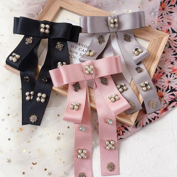 New bowknot wild pearl retro fabric steel clip spring clip top clip hair ornament headdress wholesale NHHI217447