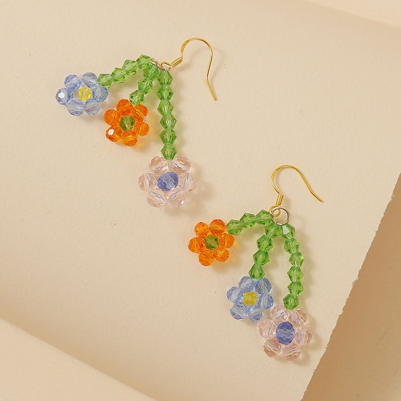 Korean hand-woven crystal rice beads flower earrings trend three flowers temperament earring jewelry wholesale nihaojewelry NHLA218170
