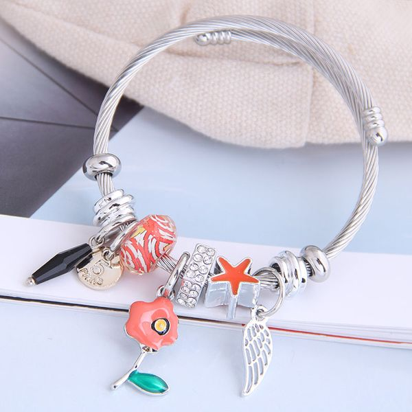 fashion metal wild pan DL simple small flower wings pendant multi-element accessories personalized bracelet wholesale nihaojewelry NHSC219331