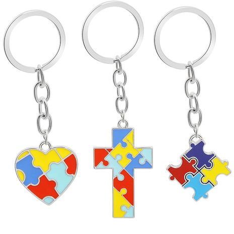 creative children's puzzle wild four-color puzzle drop oil splicing color heart-shaped cross key ring pendant wholesale nihaojewelry NHMO219140's discount tags