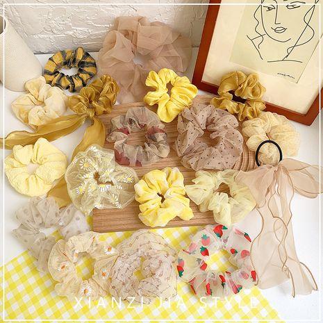 Chica amarilla cabello dulce gomas para el cabello color caramelo círculo de la cabeza salvaje cuerda círculo del intestino grueso accesorios para el cabello coreano venta al por mayor nihaojewelry NHOF219457's discount tags
