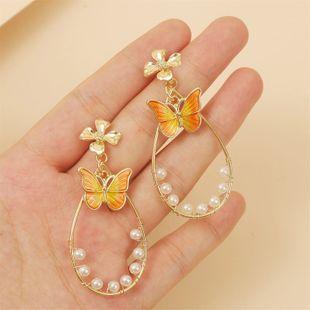Flores geométricas de moda pendientes de mariposa de gota de aceite tendencia de temperamento coreano pendientes de perlas de gota de agua joyería al por mayor nihaojewelry NHLA219496's discount tags