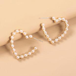 nuevos pendientes geométricos del amor pendientes de perlas de la estrella salvaje de la moda creativa venta al por mayor NHMD220017's discount tags
