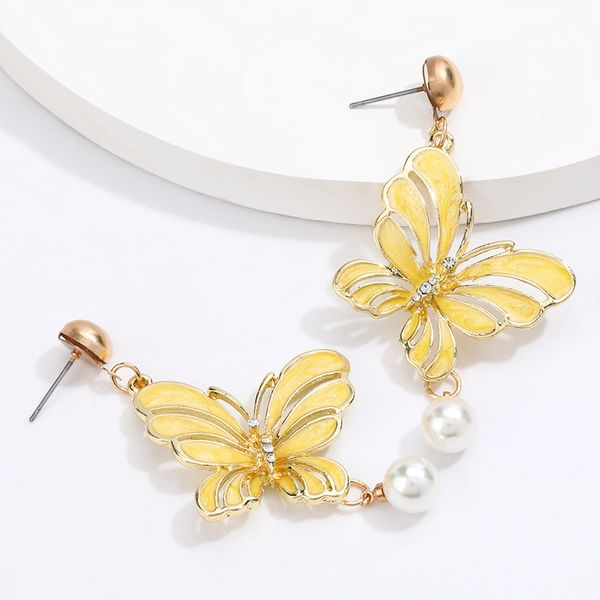 Korean animal earrings women alloy dripping butterfly imitation pearl earrings wholesale nihaojewelry NHJE220038