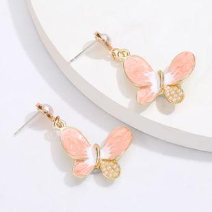 Aleación coreana gota de aceite con incrustaciones de perlas mariposa S925 pendientes de aguja de plata pendientes de corazón de niña caliente al por mayor nihaojewelry NHJE220040's discount tags
