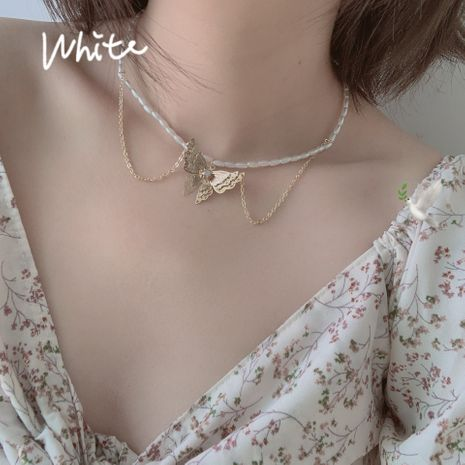 Korea new self-made double-layer pearl butterfly necklace choker clavicle chain wholesale nihaojewelry NHYQ220106's discount tags