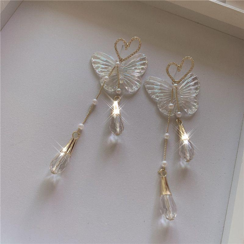 Design niche retro French butterfly earrings femininity long section Hong Kong style pearl tassels fairy air earrings wholesale nihaojewelry NHYQ220117