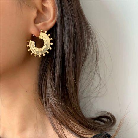sun disc exotic bead carving earrings designer simple metal niche earrings wholesale nihaojewelry NHYQ220145's discount tags