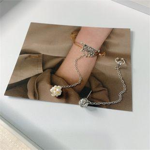 Corea nuevo diseño de nicho borla de aire mijo asimétrico perla clip de oreja oreja clip de hueso pendiente al por mayor nihaojewelry NHYQ220172's discount tags