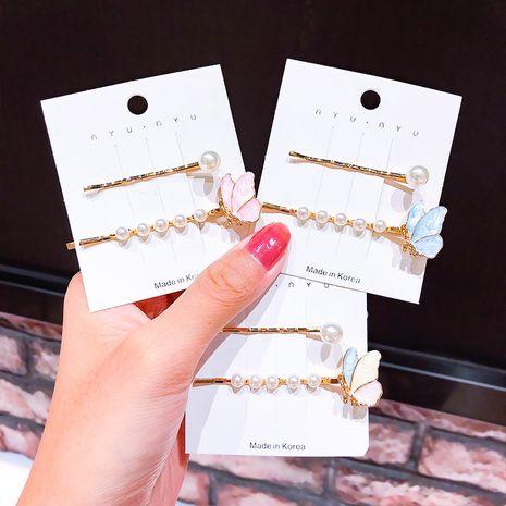 Nouveau papillon de Corée en épingle à cheveux super fée frange clip perle mot clip en épingle à cheveux goutte huile côté clip cheveux accessoires en gros nihaojewelry NHNA220308's discount tags