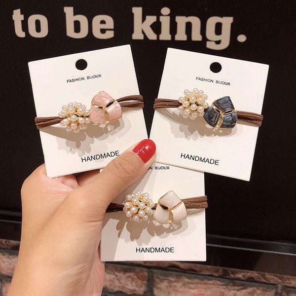 Gomas para el cabello de perlas de la nueva chica de moda elegante banda de goma de aleación de temperamento cuerda de la cabeza atada lazo de pelo anudado accesorios para el cabello coreano al por mayor nihaojewelry NHNA220321