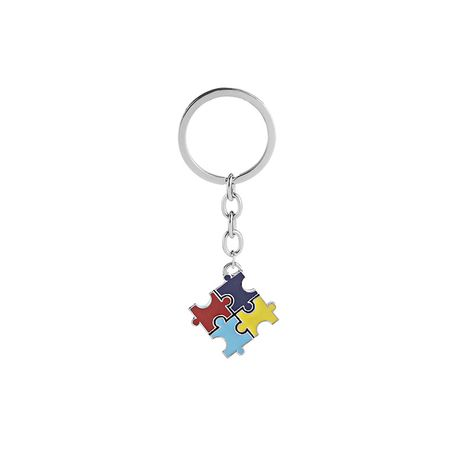 fashion explosion key chain children's four-color puzzle drip oil key chain small pendant jewelry wholesale nihaojewelry NHMO220448's discount tags