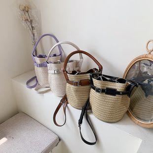 bolso de cubo de color contrastante tejido de paja de moda nueva ola verano coreano bolso de mensajero de hombro de moda al por mayor nihaojewelry NHPB220750's discount tags
