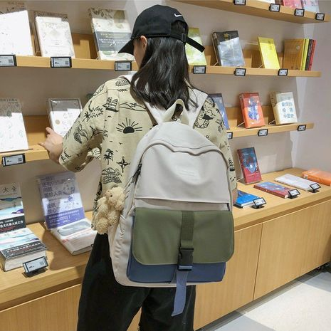 Korean fashion college style color matching mortise lock girl bag simple campus student backpack  wholesale nihaojewelry NHHX220845's discount tags