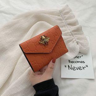 Cartera corta bolso de embrague bolsa de verano nueva bolsa de cuero suave tipo tres veces pequeña billetera al por mayor nihaojewelry NHGA220970's discount tags
