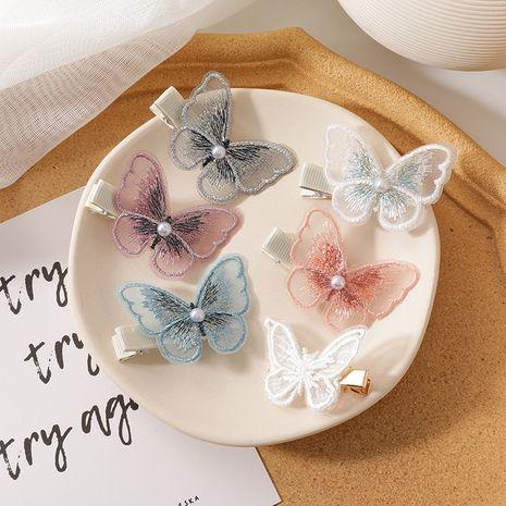 Han dulce hilo de malla simple perla mariposa horquilla yiwu nihaojewelry moda al por mayor chica popular horquilla lateral clip accesorios para el cabello NHMS213609's discount tags