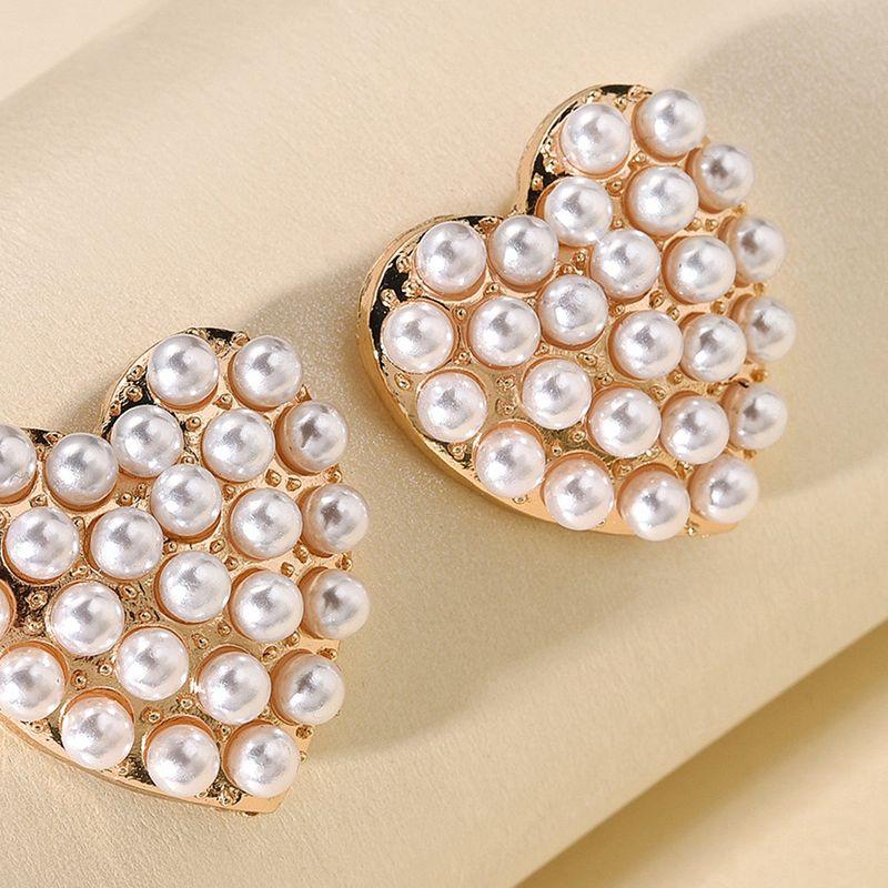 Korean new earrings fashion geometric love pearl earrings for women nihaojewelry wholesale NHMD213879