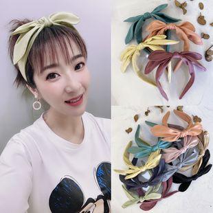 Diadema coreana nuevo color sólido lindo color caramelo doble pajarita fina diadema de satén nihaojewelry al por mayor NHSM214531's discount tags