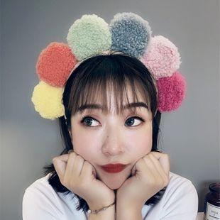Diadema linda de la moda coreana diadema de lana de cordero flor de sol diadema de colores de colores diadema ancha de felpa nihaojewelry al por mayor NHSM214534's discount tags