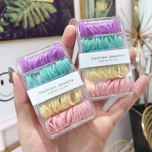 Corea nueva simple portátil de alta elasticidad desechable cuerda para el cabello set color negro en caja scrunchies baratos al por mayor NHSM214547's discount tags