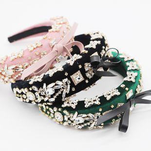 Moda coreana esponja exagerada diadema de proa con incrustaciones de diamantes señoras prom pasarela regalo diadema nihaojewelry al por mayor NHWJ214551's discount tags