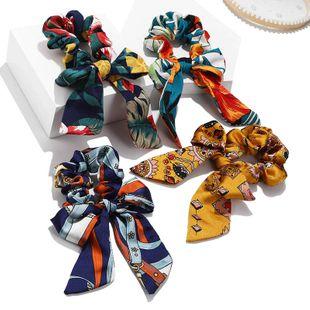 Nueva cinta de impresión de moda bowknot tela anudada paquete de cabello rizos para el cabello nihaojewelry al por mayor NHPF214584's discount tags