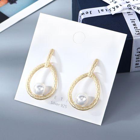 Nouveau véritable plaqué or sauvage vent froid mode simple goutte d'eau creux perle S925 argent aiguille boucles d'oreilles nihaojewelry gros NHPS214644's discount tags