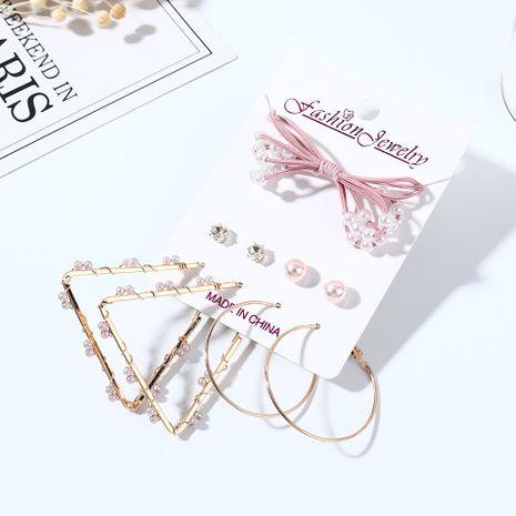 Coréen nouveau simple petit frais mode sauvage arc perle strass boucles d'oreilles bande de cheveux ensemble nihaojewelry gros NHPS214681's discount tags