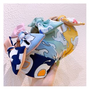 Korean retro cream cartoon little flying elephant wide-brimmed color matching bow headband hairpin nihaojewelry NHHD214907's discount tags