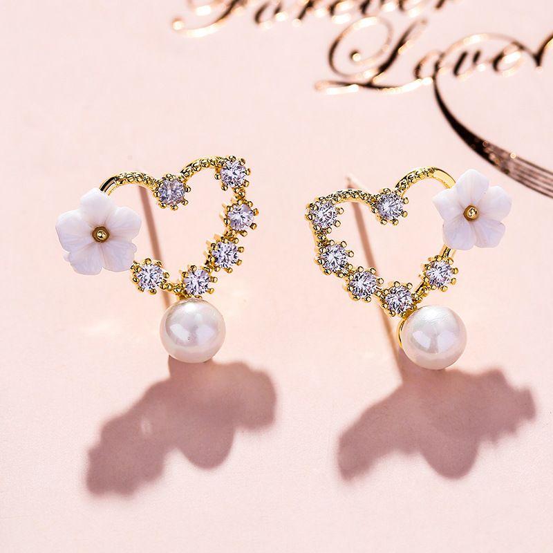Hong Kong style 925 silver needle love imitation sweet pearl flower earrings new wave personality earrings wholesale nihaojewelry NHPP221237